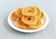 Indian Snack Chakli. Chakli, also known as murukku, which is a south Indian traditional, popular and vegetarian snack, on a plate Stock Image