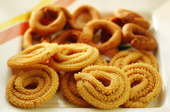 Indian Snack - Muruku and Codbele. A closeup of Muruku and Codbele which are deep fried south indian snacks Stock Photography