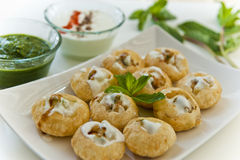 Indian Snack. Pani puri – golgappe served with yogurt Royalty Free Stock Images