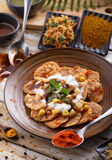 Indian snack papri chaat served with yoghurt with seasoning Stock Photo