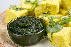 Indian Snacks Dhokla with green chutney. Made up of coriander leaves and green chillies Stock Image