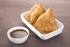 Indian Snacks Samosa with Chutney royalty free stock photo