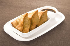 Indian Snacks Samosa with Chutney Stock Image