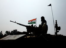 Indian Soldier and Indian National Flag. Silhouette of Indian soldier and Main Battle Tank during the 26th January Pared, 2014. Indian National Flag is on Royalty Free Stock Photos
