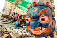 Indian souvenir market with old wooden mask of Mahakala deity, popular in Hinduism and Buddhism Royalty Free Stock Photo
