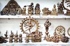 Indian souvenirs. Of shiva, Buddha, ganesha at flea market stock image
