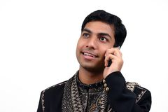 Indian speaking in the phone 1. Indian in traditional clothes speaking in the phone (1) with clipping path Royalty Free Stock Photo