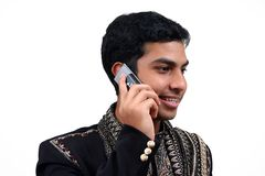 Indian speaking on phone 2. Indian in traditional clothes speaking in the phone (2) with clipping path Royalty Free Stock Image