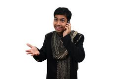 Indian speaking on phone 3. Indian in traditional clothes speaking in the phone (3) with clipping path Royalty Free Stock Photography