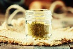 Indian spice garam masala in a glass jar, selective focus. Food still life Stock Photo