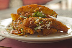 Indian Spiced Potato Wedges Stock Images