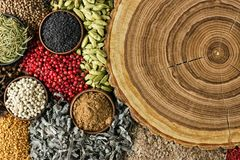 Various spices and herbs background. Condiments with empty woode Royalty Free Stock Photography