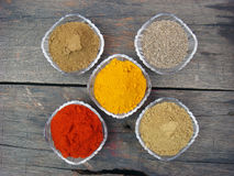 Indian spices and bowls on rusted wooden. Indian spices and crystal bowls on rusted wooden Stock Photo