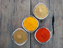 Indian spices and bowls on rusted wooden. Indian spices and crystal bowls on rusted wooden royalty free stock photography