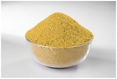 CHILLI CORIANDER POWDER GRIND FLAVOUR. INDIAN SPICES CORIANDER POWDER GRIND BOWL WOODEN YELLOW FLAVOUR MIRCH royalty free stock images