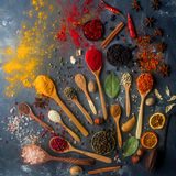 Indian spices, herbs, nuts in wooden and silver spoons and metal bowls Royalty Free Stock Photos