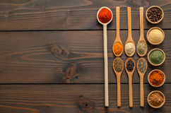 Indian spices and herbs on wooden table - Top view. Indian spices and herbs in wooden spoons on wooden table - Top view stock photos