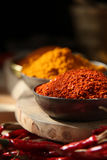 Indian Spices. Red Chilly. Indian spices table top. Chilly flakes, turmeric, and dry chilly Stock Image