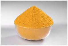 CHILLI TURMERIC POWDER GRIND FLAVOUR. INDIAN SPICES TURMERIC POWDER GRIND BOWL WOODEN YELLOW FLAVOUR MIRCH stock photo