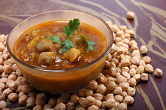 Indian spicy chana masala with raw chickpeas Stock Photos
