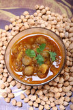 Indian spicy chana masala with raw chickpeas, cardamom on top Royalty Free Stock Photography
