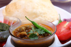 Indian spicy dish, chole bhature topping of green chili Royalty Free Stock Photo
