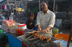 Indian spicy food. A Man is selling kebabs on a roadside food stall during the Muslim festival Muharram in India Stock Photography