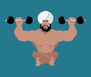 Indian sportsman. Fitness athlete from India. Yoga with dumbbell Stock Images