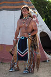 Indian. Stands about his teepee Stock Image