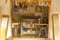 Indian street atelier tailoring with the image of Hindu deities stock image
