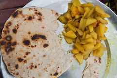 Indian street food. Chapati and curry vegetable royalty free stock images