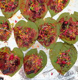 Indian street Food: Indian Paan. Made of betel leaves, areca, little past of lime, tobacco and some sweets. People used to take it after the meal as a refresher Royalty Free Stock Photo