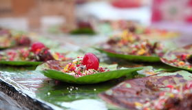 Indian street Food: Indian Paan. Made of betel leaves, areca, little past of lime, tobacco and some sweets. People used to take it after the meal as a refresher Stock Image