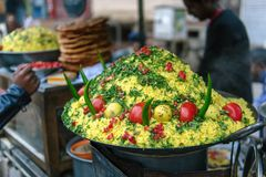 Indian street food. Rice, tomatoes, chili pepper, lime. Royalty Free Stock Photos