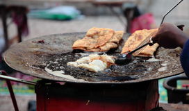Indian street Food: Stuffed Fried Bread. Indian Street Food: Vendors are frying stuffed fried bread Royalty Free Stock Photography