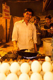 Indian street food vendor cooking omelet Royalty Free Stock Images