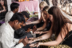 Indian street  master uses  henna paste or mehndi Royalty Free Stock Images