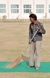 Indian street sweeper. Honest on his job,photo taken on 11-12-2010 in rayat collage Royalty Free Stock Photo