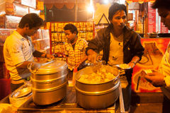 Indian street vendor make fast food in evening Stock Images