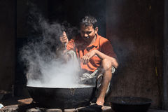 Indian street vendor make fast food  in old wok the fire . Pushkar, India Stock Photos