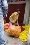 Indian Street Vendor with Marigolds in Mumbai India Stock Photo