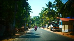 Indian street from window in the bus Kerala India Timelapse stock footage