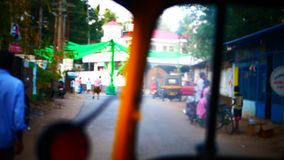Indian street from window in the bus Kerala India Timelapse stock video footage