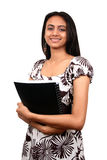 Indian Student. With books in hand, isolated over white background Royalty Free Stock Image