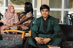 Indian Student wearing his traditional attire. In the College campus Stock Photo