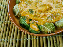 Indian stuffed  curry cabbage. With brown rice and vegetables - Bandh gobi ki rolls Stock Photo
