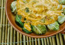 Indian stuffed  curry cabbage. With brown rice and vegetables - Bandh gobi ki rolls Stock Images