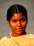 Indian Style. A poor Indian girl poses for the camera Royalty Free Stock Photo