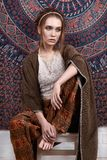 Indian style beauty girl. Sitting over patterns.fashion beautiful woman Royalty Free Stock Photos