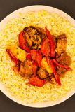 Indian Style Chicken Jalfrezi Curry And Pilau Rice. Against A Black Background Stock Images